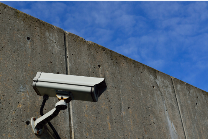 Security camera mounted on concrete wall